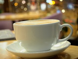 Cappuccino cup against background of lights - 196083402