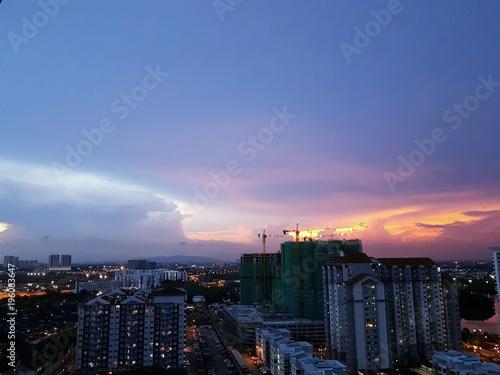 Colorful dramatic pastel evening sky over cityscape of Johor Bahru, Malaysia