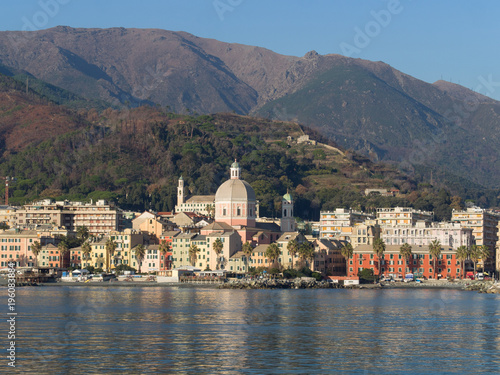 Foto op Canvas Liguria Pegli, neighbourhood of Genoa, typical buildings reflecting in the sea