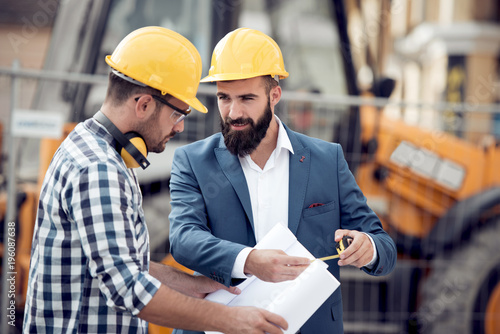 Construction specialist and worker outdoors © ivanko80