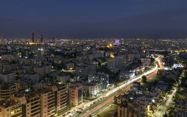 view of Amman's new downtown and abdoun bridge at night