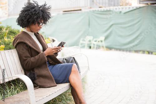 Plexiglas Kapsalon Woman reading a text message on her phone