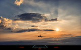 Silhouette of airplane landing to airport runway with beautiful sunset light