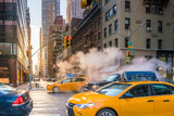 Manhattan morning sunrise view with yellow cabs - 196103697