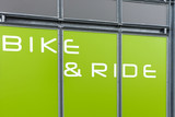 Detail of modern bicycle parking area in green color - 196140638