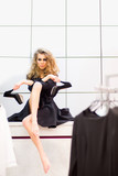 Fashion model with black high heel shoes in dressing room - 196147000