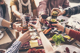Group of people having meal togetherness dining toasting glasses - 196150493