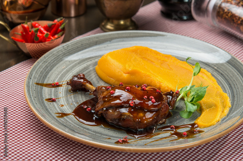 Roasted duck leg with pumkin puree - 196159648