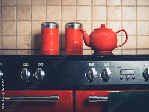 Fototapeta Teapot on the stove in kitchen