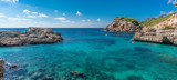 Panoramic view of crystalline turquoise waters of Cala s'Almunia beach from cap des moro. Located in Santanyi, Majorca, Balearic Islands, Spain. - 196174000