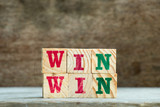 Letter block in word win win on wood background - 196174471