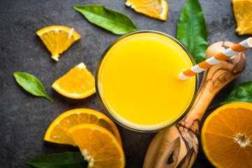 Orange juice in glass on black.