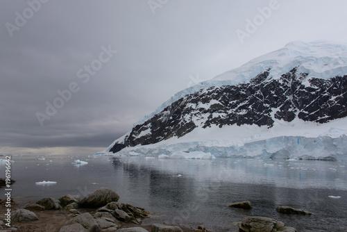 Antarctic beach with glacier