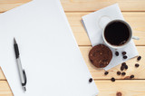 Coffee with cookies and clean paper