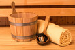 Leinwanddruck Bild - Sauna Wooden Bucket, Ladle, Essential oils and Towel