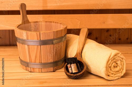 Leinwanddruck Bild Sauna Wooden Bucket, Ladle, Essential oils and Towel