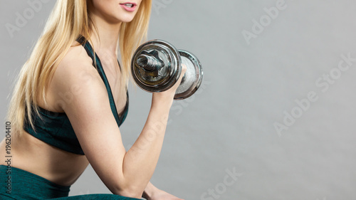 Wall mural Woman training weight lifting