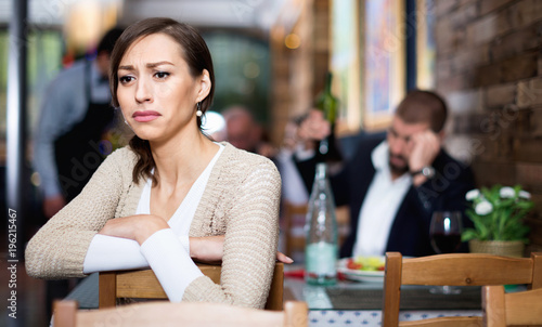 Portrait of upset man and woman in the restaurant on meeting
