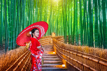 Bamboo Forest. Asian woman wearing japanese traditional kimono at Bamboo Forest in Kyoto, Japan. © tawatchai1990