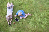 Top view of kids in grass with tablet and smartphone - 196220402