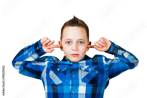 Poster Handsome boy covering his ears ignoring noise. Isolated on white.
