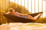 Young slim woman in tropical exotic hammock - 196222607