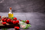 Organic vegetarian ingredients, olive oil and seasoning on rustic wooden cutting board over dark vintage background with space for text.Healthy food, or diet nutrition concept.Fresh Vegetables - 196226208