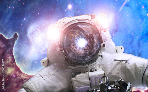 Tuinposter Heelal Asrtonaut in the space on the pillar of creation background. Elements of this image furnished by NASA
