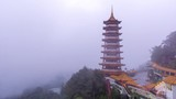Time lapse of moving clouds and fog over Chin Swee Caves Temple in Malaysia - 196263835