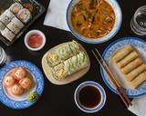 Soup, spring rolls, and sushi rolls - 196268007