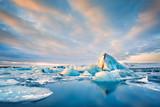 Icebergs float on Jokulsarlon glacier lagoon at sunrise, in Iceland. - 196274095