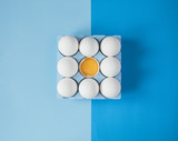 White raw chicken eggs on colorful blue background - 196283007