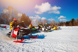 Snowmobile. Snowmobile races start in snow. Concept winter sports, racers.