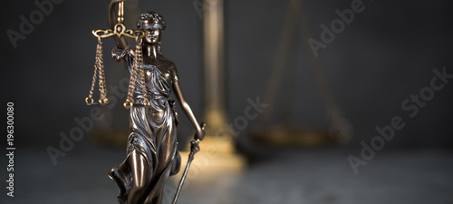 Law and Justice concept. Mallet of the judge, books, scales of justice. Gray stone background, reflections on the floor, place for typography. Courtroom theme. - 196300080