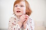 The girl says something plaintively - 196301886