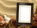 Pictue frame on shells and sand background. Copy space. - 196306608