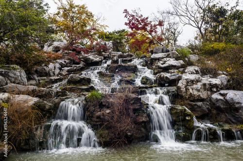 Plexiglas Herfst Falling stream in autumn