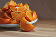 Cut tangerines on wooden table
