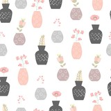 Seamless floral pattern. Cute vector ornament with flowers in vases.