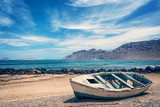 Old colorful fishing boat, atlantic ocean in the background, Lanzarote, Canary islands, Spain - 196330051