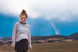 beautiful pregnant woman and a rainbow outdoors in nature - 196332660