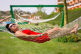 Beautiful woman relaxing on the hammock - 196347647