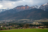Scenic view of Koscielisko village with panorama of High Tatras on background, Poland