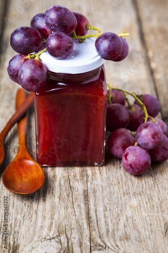 Wall mural Jar of  jam and grapes