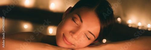 Leinwanddruck Bild Luxury spa massage woman. Pampering whirlpool jacuzzi lifestyle girl relaxing in hot water banner panorama.