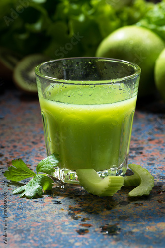 Poster Sap glass of juice of celery and greens, vertical, closeup