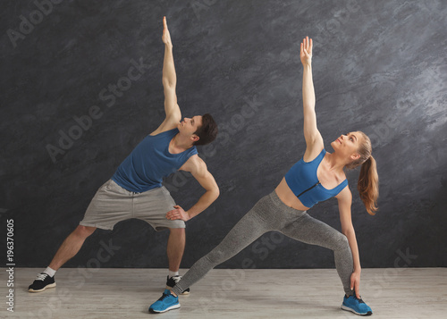 Fitness couple warmup stretching training indoors