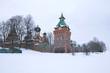 Overcast winter day at the walls of the Pyukhtitsky Assumption Monastery. Kuremae, Estonia