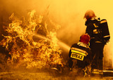 firefighters extinguishing a dangerous fire © Mike Mareen