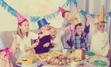 Children having fun during friend's birthday party - 196389035